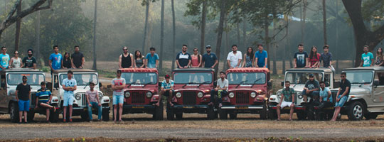 Students stand by Jeeps in Goa, India